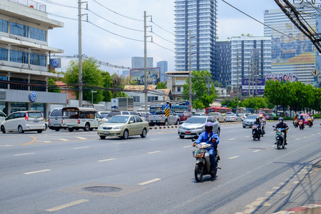 car lots: Bangkok - April 29: Traffic moves slowly along a busy road on April 29, 2015 in Bangkok, Thailand. Annually an estimated 150,000 new cars join the already heavily congested streets of Bangkok.