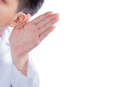 disobedient: Doctor holds his hand near his ear and listening Stock Photo