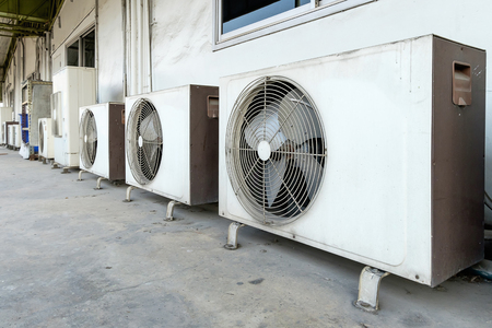 compresor: Air conditioner compressor installed in old building