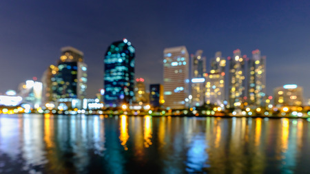 benjakitti: Blurred from Bangkok city downtown at night with reflection of skyline