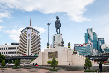 lumpini: Bangkok, Thailand - June 10, 2016: The monument of king RAMA VI in front of Lumpini park, in a center of business district in Bangkok, Bangkok sky-scape, Bangkok city-scape, Bangkok, Thailand.