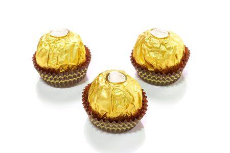 ferrero: Bangkok, Thailand - January 5, 2015: Ferrero Rocher is a chocolate brand made by Italian manufacturer Ferrero SpA. Ferrero SpA is the biggest chocolate producer in the world.