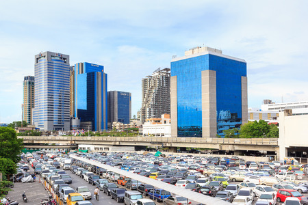 Bangkok, Thailand - May 17, 2014: Cars were parked at Chatuchak BTS station parking lot for BTS skytrain transit to solve traffic jam in Bangkok and facilitate people to commute in capital city