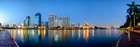 Bangkok, Thailand - June 6, 2016: Benchakitti Park near the skyscraper business district,Bangkok city with park at twilight with reflection of skyline, Bangkok,Thailand