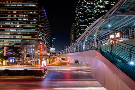 Bangkok, Thailand - March 2, 2016: Sky walker at the center connected to electric train station colorful in night bangkok city