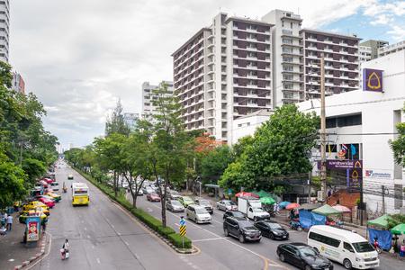 Bangkok, Thailand - June 10, 2016: Traffic moves slowly along a busy road front of Chulalongkorn hospital in Bangkok, Thailand.