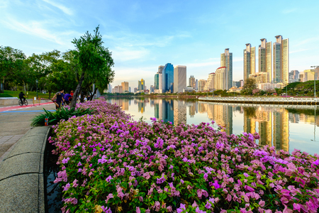 benjakitti: Bangkok, Thailand - February 10, 2017: Benjakitti park, Bangkok downtown city in the evening with skyline reflection.