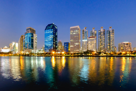 estate: Bangkok city downtown at night with reflection of skyline, Bangkok,Thailand
