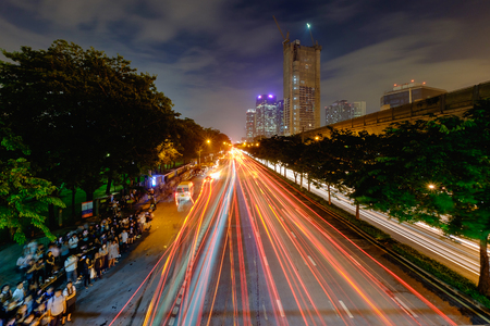 Bangkok, Thailand - November 9, 2016: Cityscape of light trails with blurred colors on the street at night.