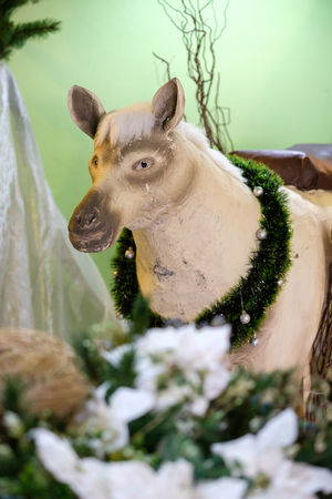 creche: Bangkok, Thailand - December 16, 2016: Christmas Manger scene with models including an empty manger, camel and donkeys.