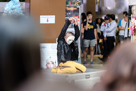 Bangkok, Thailand - January 15, 2017: White face clowning, Street show front of Siam Square.