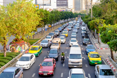 Bangkok, Thailand - March 6, 2017: Traffic moves slowly along a busy road in Bangkok, Thailand. Annually an estimated 150,000 new cars join the already heavily congested streets of Bangkok.