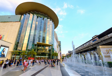 Bangkok, Thailand - Jan. 27, 2017: Shoppers visit Siam Paragon mall in Siam Square mall on in Bangkok, Thailand. With 300,000 m 2 of retail space Siam Paragon is one of the largest malls in the world.