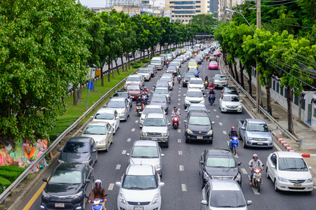 Bangkok, Thailand - August 7, 2017: Traffic moves slowly along a busy road in Bangkok, Thailand. Annually an estimated 150,000 new cars join the already heavily congested streets of Bangkok.