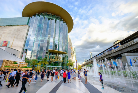 Bangkok, Thailand - Aug. 18, 2017: Shoppers visit Siam Paragon mall in Siam Square mall on in Bangkok, Thailand. With 300,000 m 2 of retail space Siam Paragon is one of the largest malls in the world.