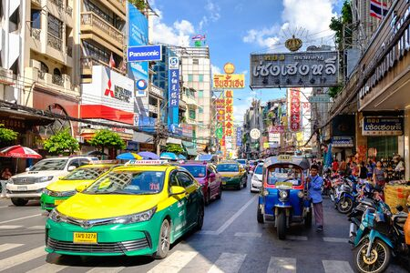 Bangkok, Thailand - August 13, 2017: Cars and shops on Yaowarat road. Chinatown with notable Chinese buildings, restaurants and decoration. Busy Yaowarat Road.
