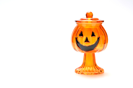 Jack-o-lantern candy glass jar on white background Stock Photo