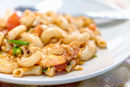 Macaroni, shrimp with tomato sauce