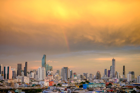 Bangkok city at dusk with rainbow Stock Photo