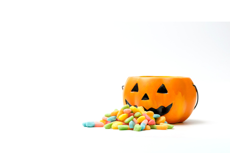 Halloween pumpkin with a pile of colorful candy
