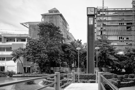 Bangkok, Thailand - September 16, 2017: Clock tower structure at Chantharakasem university. Chantharakasem university is local university at north of Bangkok.
