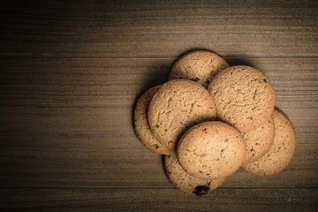 Crunchy malt cookies on dark old wooden table, Top view with copy space for text.