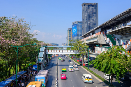 Bangkok, Thailand - March 9, 2017: Cars, buses, taxis and people crowd on street at Jatujak market Bangkok. Jatujak is the largest market in Thailand and the worlds largest weekend market.