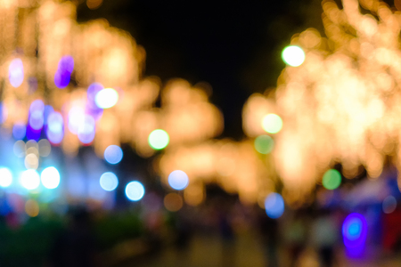Abstract Crowd and Lights, an abstract look at the Beautiful lighting and the people in Fair at Public Park. Stock Photo