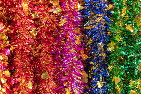 Glittering rainbow Christmas Tree Decoration have red pink blue and green color. Luxurious and gorgeous ornament material for christmas and new year party or event. Close up concept.
