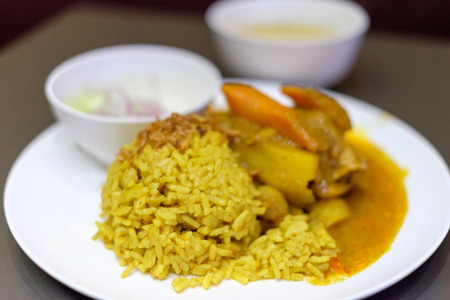 Food service: Chicken Biryani (Muslim yellow rice with chicken)
