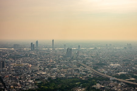 Air pollution from Lots of dust or PM2.5 particle exceeds the standard at Bangkok city, Thailand. Negative effect on Respiratory system and health. - Image Stock Photo