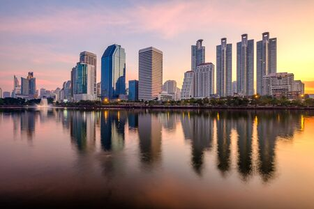 Business district cityscape from a park with sunrise time from Benchakitti park, Bangkok Thailand. Zdjęcie Seryjne