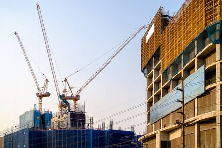 Construction site and sunset, structural steel beam build large residential buildings at construction site