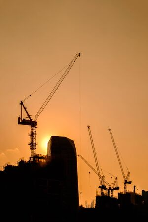 Tower crane on a construction site at sunrise Zdjęcie Seryjne