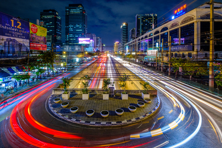 Bangkok, Thailand - January 3, 2019: Long exposer Aerial view night underground tunnel and U-turn traffic road with car light movement, Night transport 에디토리얼