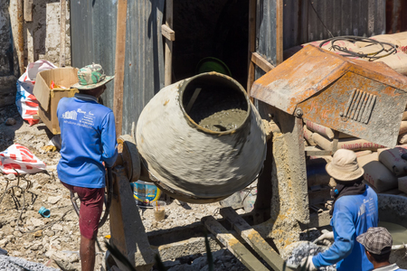 Bangkok Thailand - March 9, 2019: Unidentified workers pour ready mix concrete from a concrete mixer.