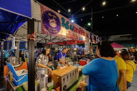 Nakhon Ratchasima, Thailand - March 15, 2019: Nom Neaw, Shave ice with Sweetened condensed milk in Sikhio night market a famous night market where many people come to try Thai food and go shopping in Korat, Thailand Publikacyjne