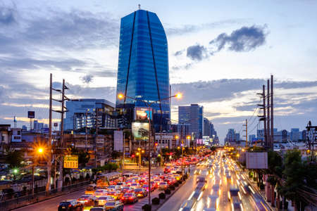 Bangkok, Thailand - Aug. 2, 2018: Traffic jam and new Provincial Electricity Authority (PEA) building background. New Landmark of Bangkok Soon on Rama 4 Road.