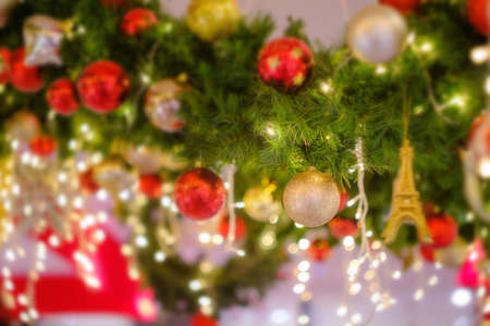 Colorful christmas ball on the branches fir and green background, Soft.