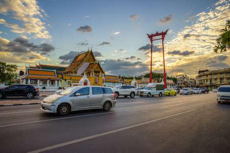 Bangkok, Thailand, December 1, 2020: The giant swing (Sao Ching Cha) with movement car and traffic jam in Bangkok, Thailand.