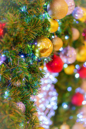 Colorful christmas ball on the branches and green background, Soft Фото со стока