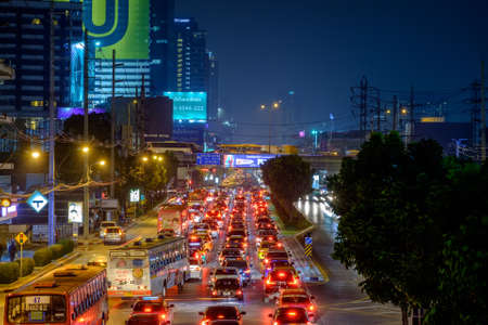 Bangkok, Thailand - Nov. 14, 2018: Traffic jam moves slowly along a busy road in city center in Bangkok. Annually an estimated 150,000 new cars join the heavily congested streets of the Thai capital.