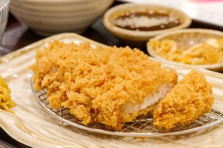 Tonkatsu, Japanese food. Breaded pork cutlet. Pork loin cutlet. Фото со стока