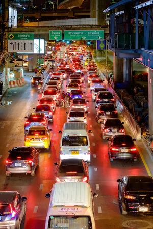 Bangkok, Thailand - February 14, 2020: Many car, bus and motorcycle cause traffic jams at Phahonyothin Road. BTS or Bangkok skytrain at Ha Yaek Lat Phrao Station. with Overpass at Central Plaza Ladprao