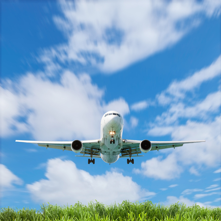 Airplane in the sky with beautiful green grass blue sky scenery background,open high season travel and tour concept
