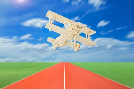 runways: Wood airplane with runways against beautiful sky background