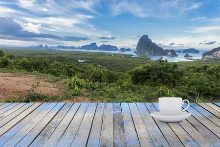 Empty white Coffee cup with Wood floor ,Samet-nang-she beautiful scenery new landmark in Phang nga ,Thailand