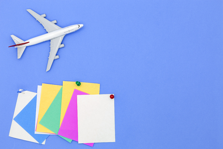 Airplane model with various paper ball and stick paper note on blue background with copy space.Preparation for Traveling and tour concept Stock Photo - 76327565