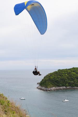 paraglider extreme sports in phuket thailand Stock Photo - 76327625