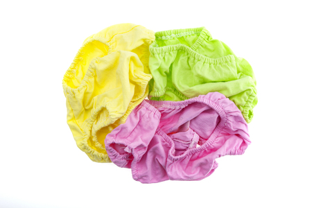 messy clothes: pile of dirty laundry Isolated on white background